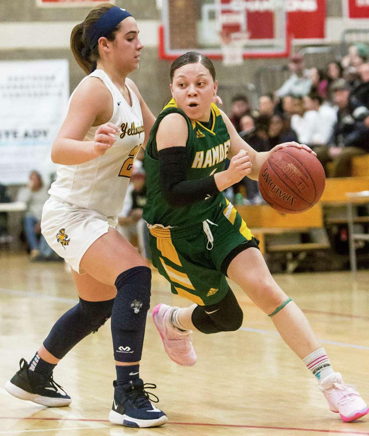 Hamden's Asya Brandon drives the lane past East Haven defender Isabella Ragaini during the SCC championship game on Wednesday.