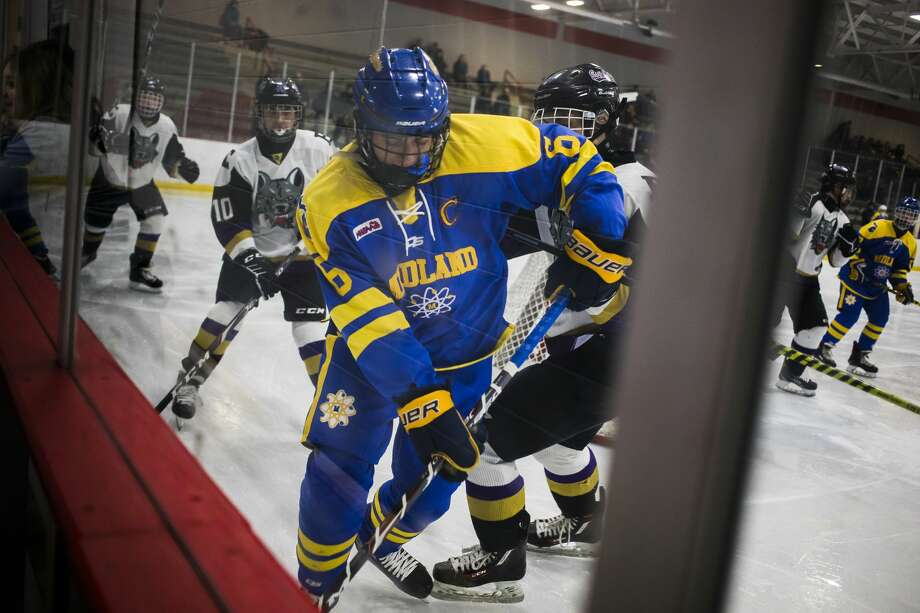 Midland High's Tyler Pritchett fights for possession during a hockey game against Bay City on Feb. 26, 2020 at Midland Civic Arena. (Katy Kildee/kkildee@mdn.net) Photo: (Katy Kildee/kkildee@mdn.net)