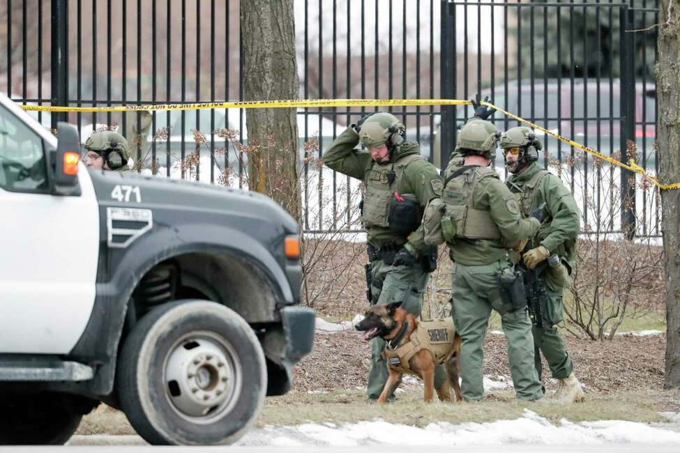 Police work outside the Molson Coors Brewing Co. campus in Milwaukee on Wednesday, Feb. 26, 2020, after reports of a possible shooting. (AP Photo/Morry Gash)