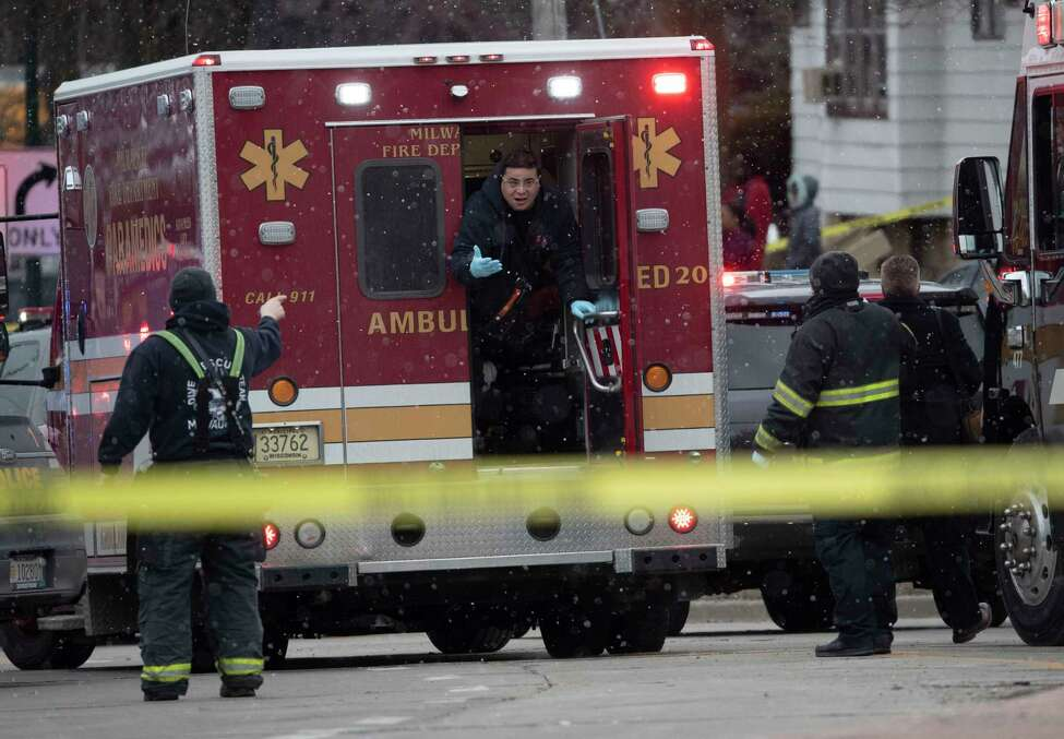 Milwaukee Police and Milwaukee Fire Dept. personnel respond to reports of an active shooting at the Molson Coors Brewing Co. campus in Milwaukee, Wednesday, Feb. 26, 2020. (Mark Hoffman/Milwaukee Journal-Sentinel via AP)