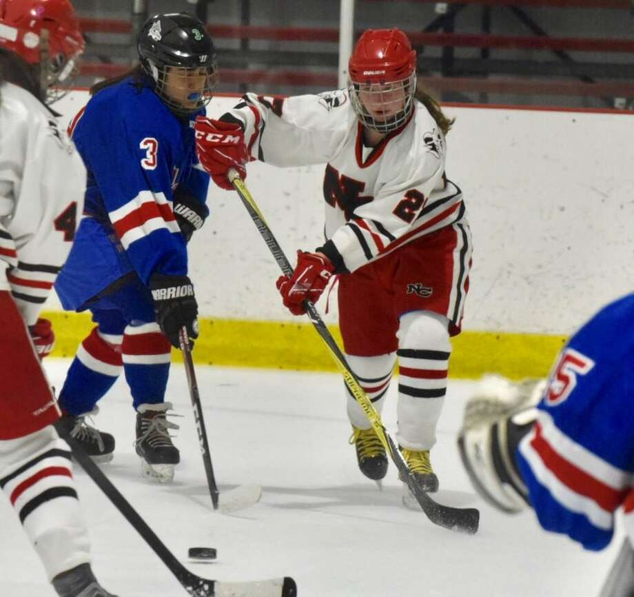 New Canaan's Maddie Kloud (27) sends a pass to a teammate during the Rams' game against Fairfield in the FCIAC girls ice hockey semifinals at the Darien Ice House on Wednesday, Feb. 26, 2020. Photo: David Stewart / Hearst Connecticut Media / Connecticut Post