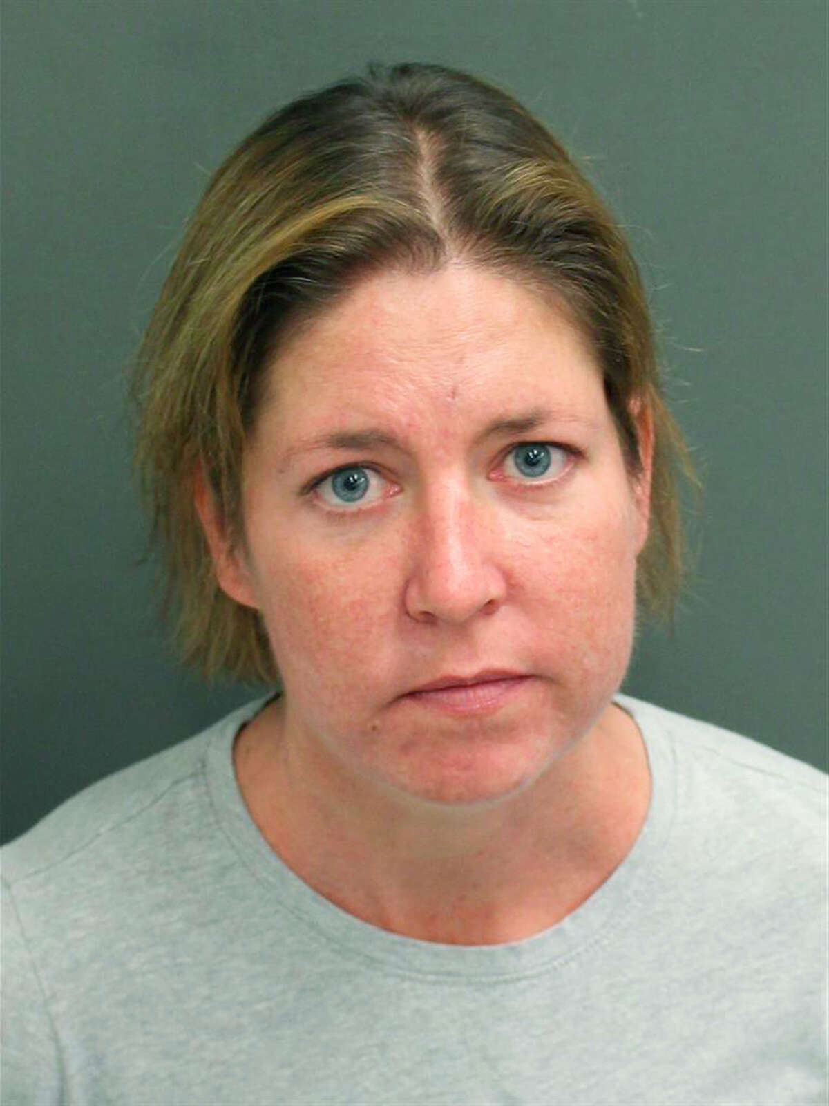 This Monday, Feb. 24, 2020 booking photo from the Orange County Sheriffa€™s Office shows Sarah Boone. Boone is accused of zipping her boyfriend into a suitcase, recording his repeated cries for help and leaving him locked inside until he died, according to sheriff's office documents. (Orange County Sheriffa€™s Office via AP)