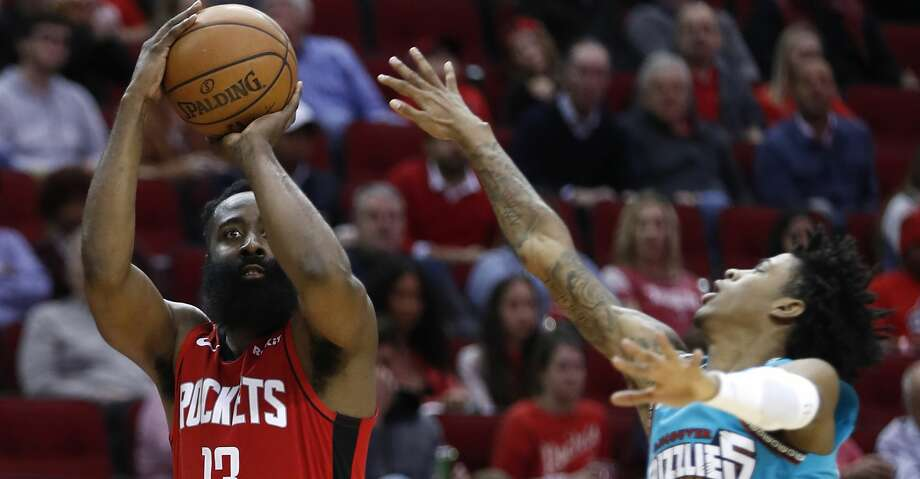 Houston Rockets guard James Harden (13) shoots a 3-pointer with Memphis Grizzlies guard Ja Morant (12) defending during the second half of an NBA basketball game on Wednesday, Feb. 26, 2020, at Toyota Center in Houston. Photo: Brett Coomer/Staff Photographer