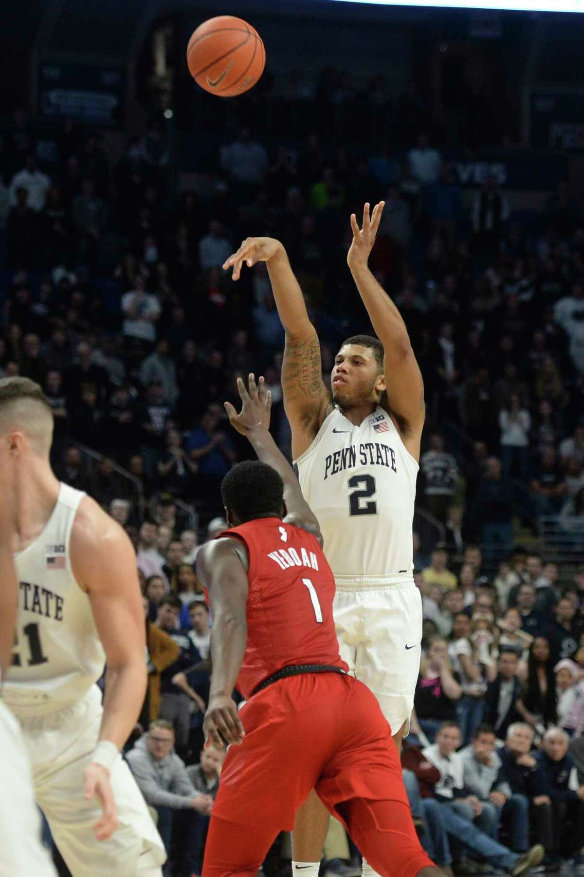 Penn State's Myles Dread's (2) shoots a 3-point basket from the top of key over Rutgers Akwasi Yeboah (1) during the second half of an NCAA college basketball game, Wednesday, Feb. 26, 2020, in State College, Pa. (AP Photo/Gary M. Baranec)