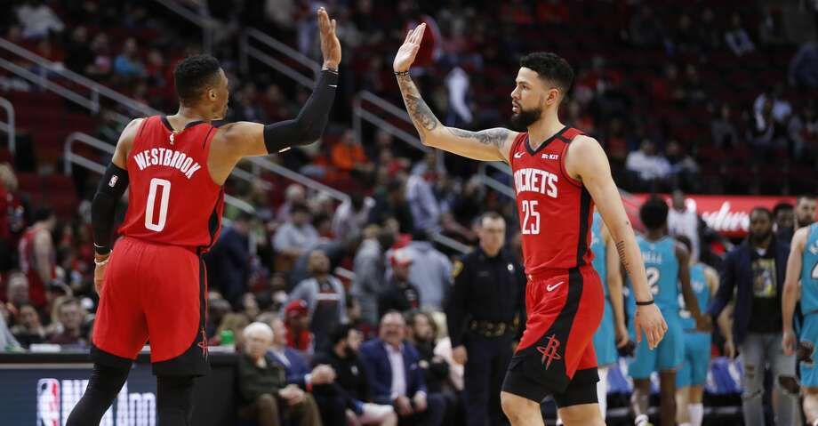 Houston Rockets guards Russell Westbrook (0) and Austin Rivers (25) high five during a break in the action against the Memphis Grizzlies during the second half of an NBA basketball game on Wednesday, Feb. 26, 2020, at Toyota Center in Houston. Photo: Brett Coomer/Staff Photographer