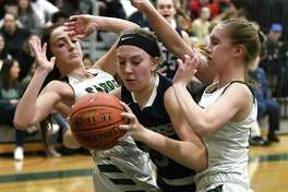 Cobleskill's Meghan Ellis drives to the basket against Schalmont's Payton Graber, left, and Siena Hallberg during a game on Wednesday, Feb. 26, 2020 in Rotterdam, N.Y. (Lori Van Buren/Times Union)