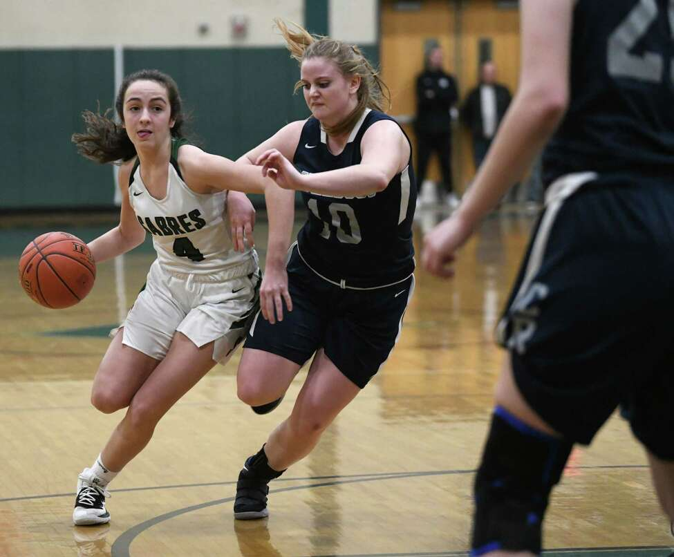 Schalmont's Payton Graber drives to the basket against Cobleskill's Jessica Meade during a game on Wednesday, Feb. 26, 2020 in Rotterdam, N.Y. (Lori Van Buren/Times Union)