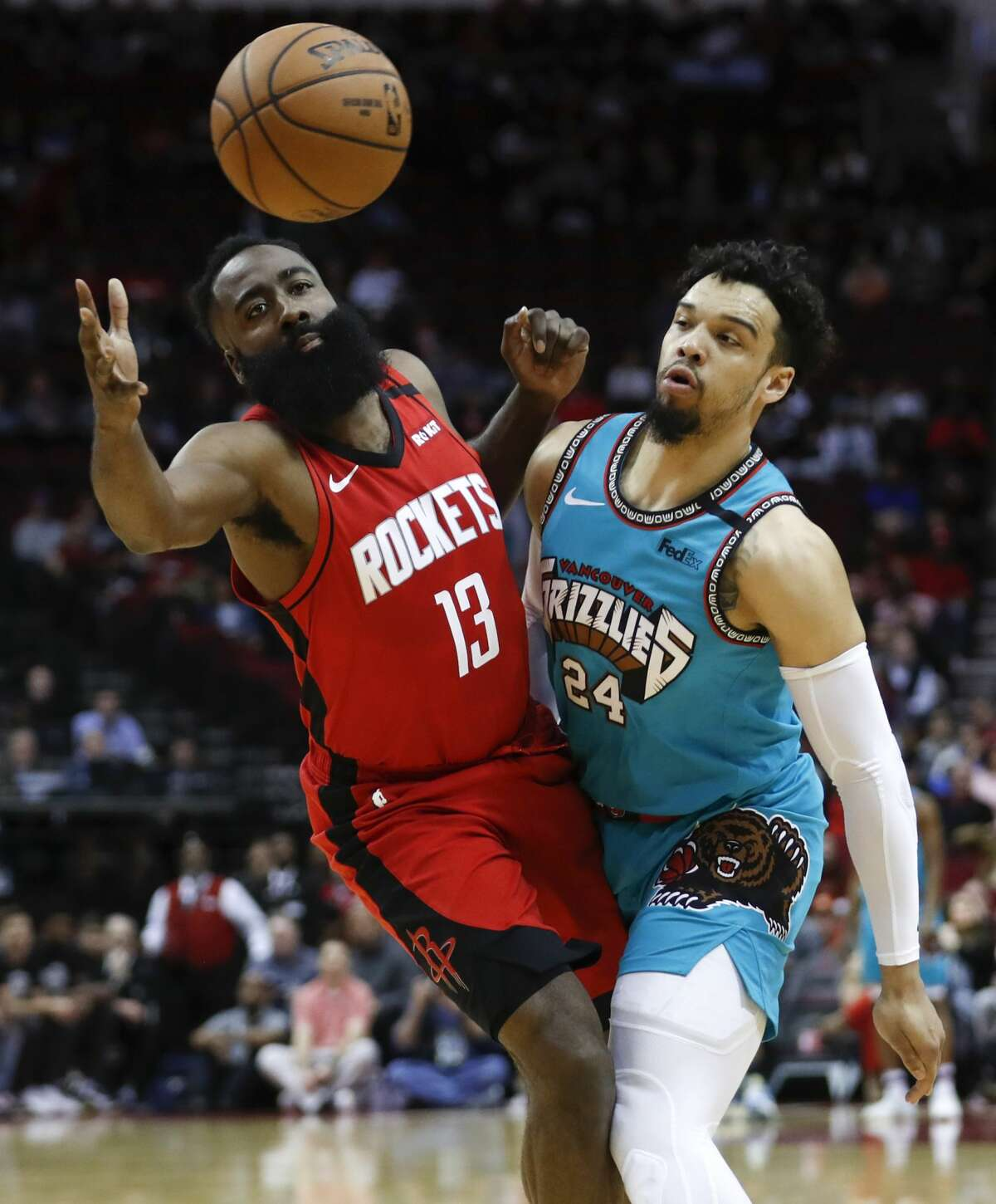 Houston Rockets guard James Harden (13) takes an inbounds pass defended by Memphis Grizzlies guard Dillon Brooks (24) during the first half of an NBA basketball game on Wednesday, Feb. 26, 2020, at Toyota Center in Houston.