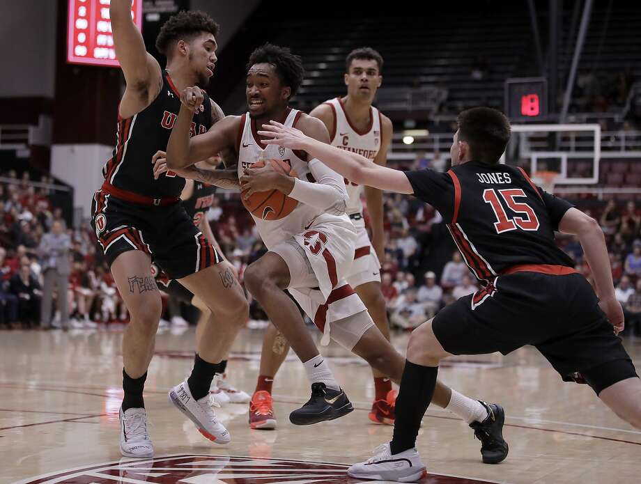 Stanford's Bryce Wills, center, drives the ball between Utah's Timmy Allen, left, and Rylan Jones (15) in the first half of an NCAA college basketball game Wednesday, Feb. 26, 2020, in Stanford, Calif. (AP Photo/Ben Margot) Photo: Ben Margot / Associated Press