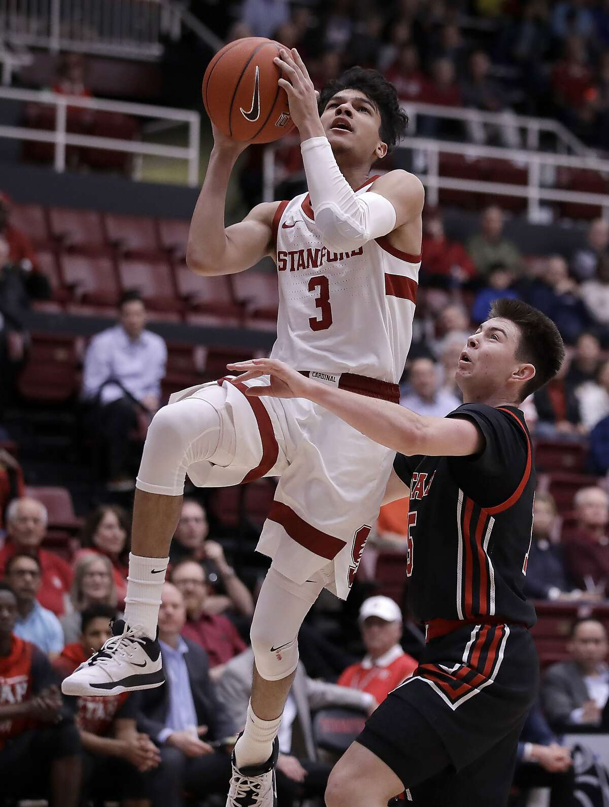 Stanford's Tyrell Terry (3) shoots against Utah's Rylan Jones, right, in the first half of an NCAA college basketball game Wednesday, Feb. 26, 2020, in Stanford, Calif. (AP Photo/Ben Margot)