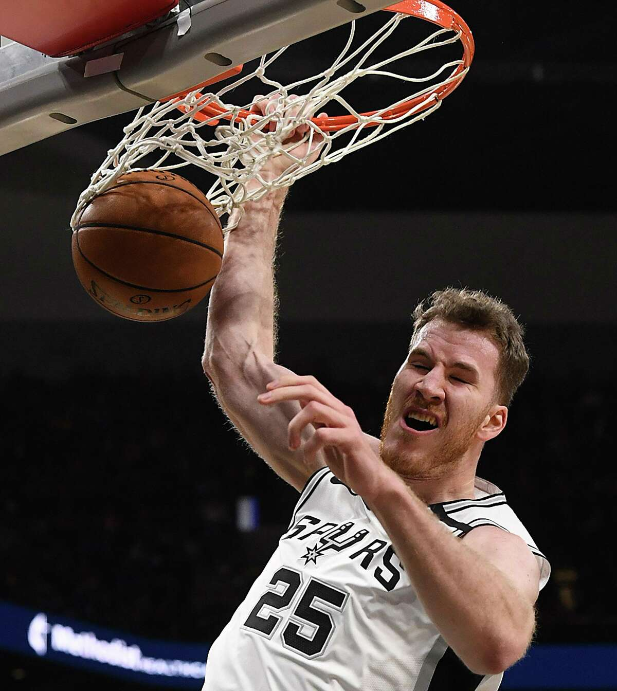 Jakob Poeltl of the San Antonio Spurs dunks as Maxi Kleber of the Dallas Mavericks watches during first-half NBA action in the AT&T Center on Wednesday, Feb. 26, 2020.