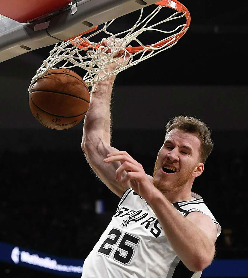 Jakob Poeltl of the San Antonio Spurs dunks as Maxi Kleber of the Dallas Mavericks watches during first-half NBA action in the AT&T Center on Wednesday, Feb. 26, 2020. Photo: Billy Calzada, San Antonio Express-News / Staff Photographer / ***MANDATORY CREDIT FOR PHOTOG AND SAN ANTONIO EXPRESS-NEWS /NO SALES/MAGS OUT/TV