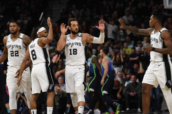 The Spurs' Rudy Gay, from left, Patty Mills, Marco Belinelli and Lonnie Walker IV will try to make the playoffs without LaMarcus Aldridge in Florida.