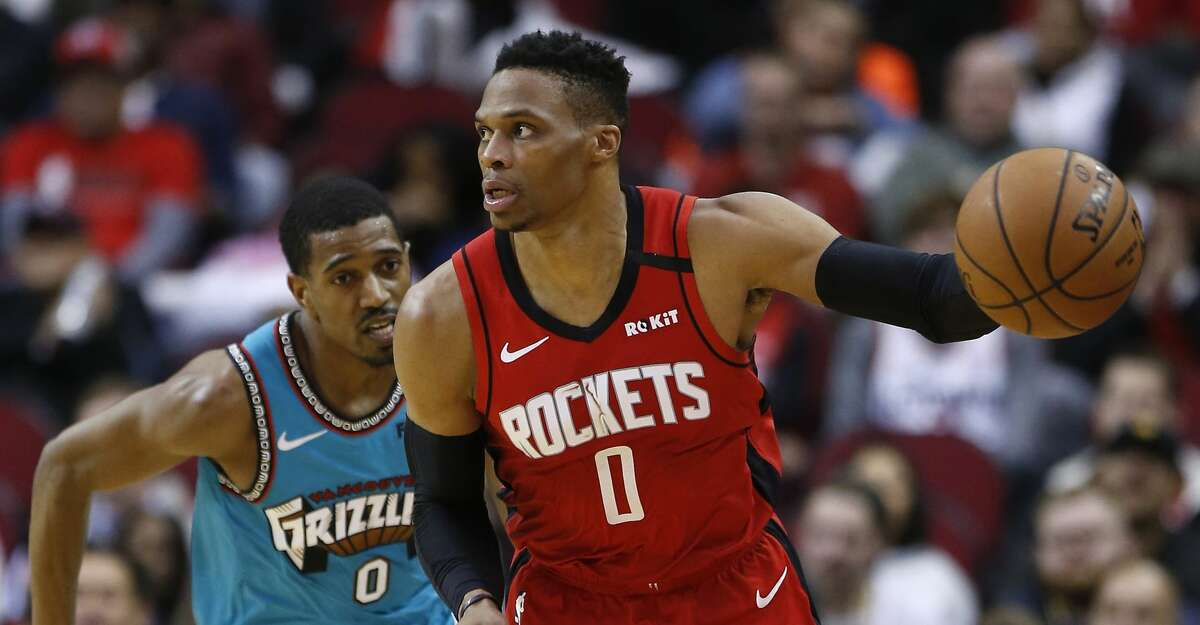 Houston Rockets guard Russell Westbrook (0) runs past Memphis Grizzlies guard De'Anthony Melton as he takes the ball up court during the second half of an NBA basketball game on Wednesday, Feb. 26, 2020, at Toyota Center in Houston.
