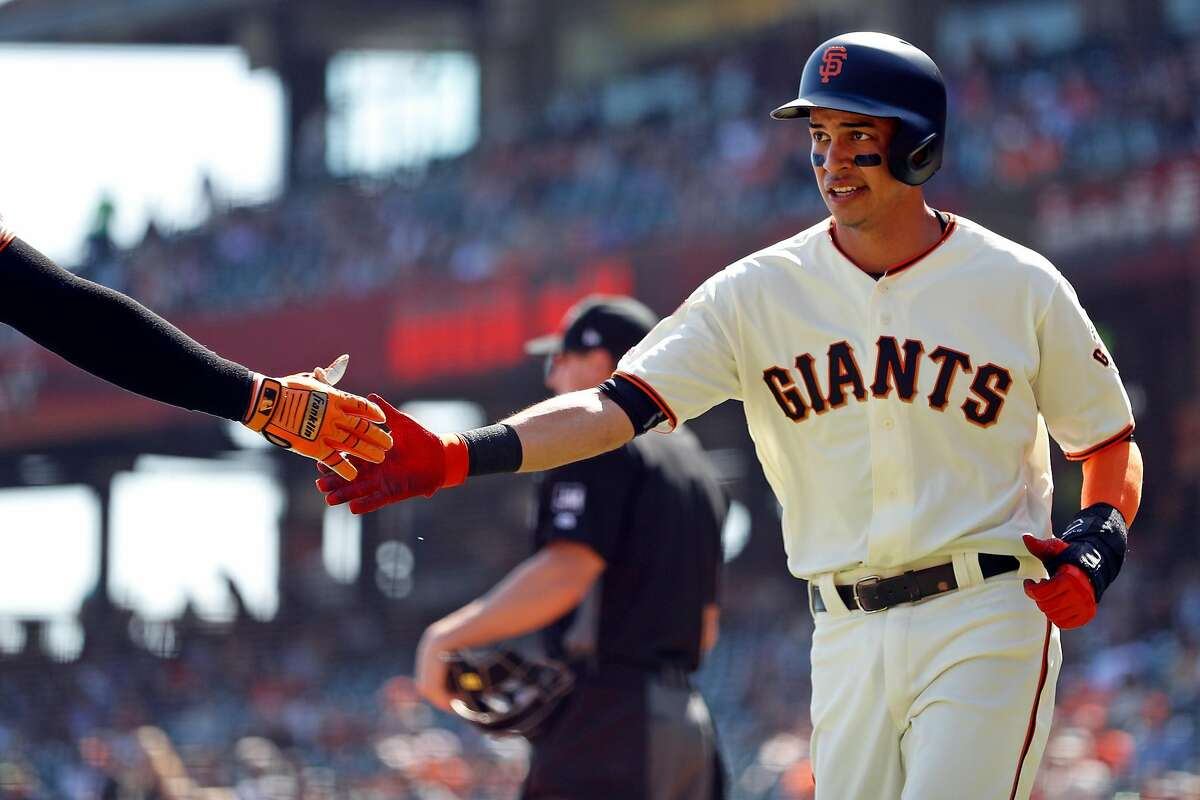 San Francisco Giants' Mauricio Dubon scores after single by Kevin Pillar in 1st inning against Colorado Rockies during MLB game at Oracle Park in San Francisco, Calif., on Thursday, September 26, 2019.
