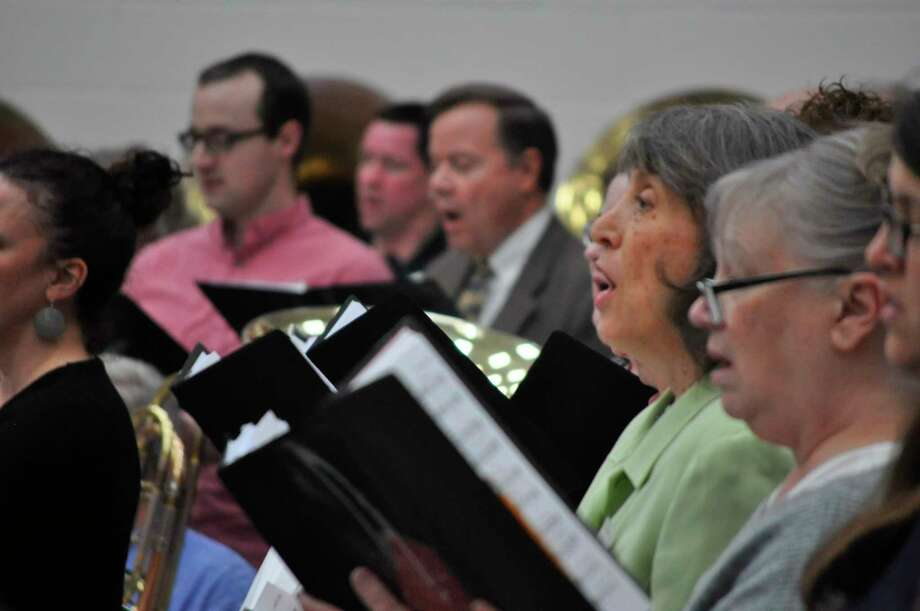 """Choir members sing during a rehearsal for """"Lamb of God"""" on Sunday, Feb. 23 at H. H. Dow High School. Lamb of God will perform Friday, Feb. 28 and Saturday, Feb. 29. (Photo provided)"""
