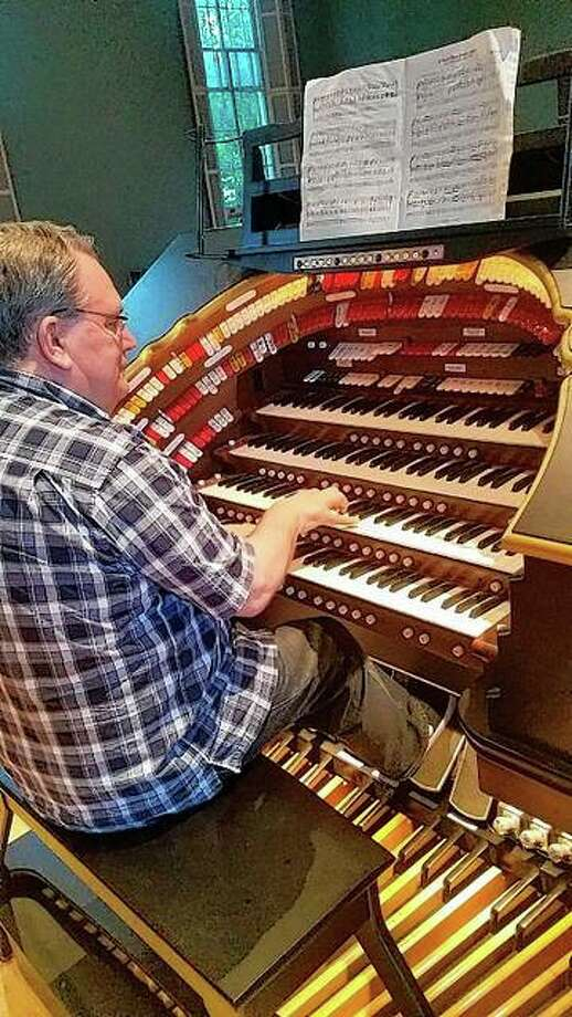 "Organist Mark Gifford of Springfield plays the four-manual digital Allen theater organ at Lovejoy Hall. Gifford will provide the accompaniment Friday for a screening of the Buster Keaton silent film ""Steamboat Bill Jr."" Photo: Photo Provided"