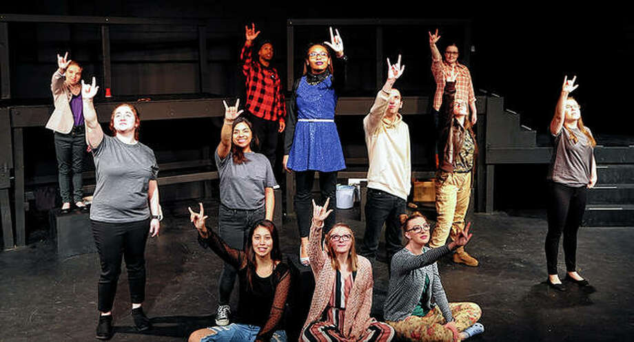 "Members of the cast of the MacMurray College production of the musical ""Godspell"" sign the phrase ""I love you"" in American Sign Language. The play takes the stage this weekend at MacMurray's Marian Chase Schaeffer Theatre inside Jenkins Education Complex. Photo: Photo Provided"