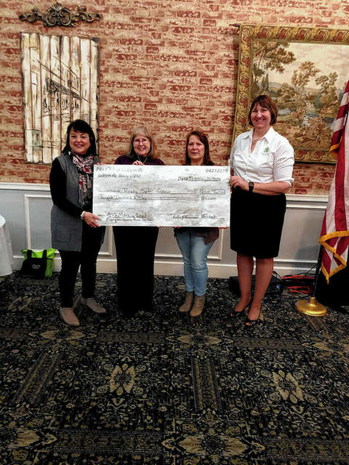 Members of the Jacksonville Pilot Club present an $8,000 grant to the Ready, Set, Grow program Wednesday. Photo: Photo Provided By Lisa Pierce