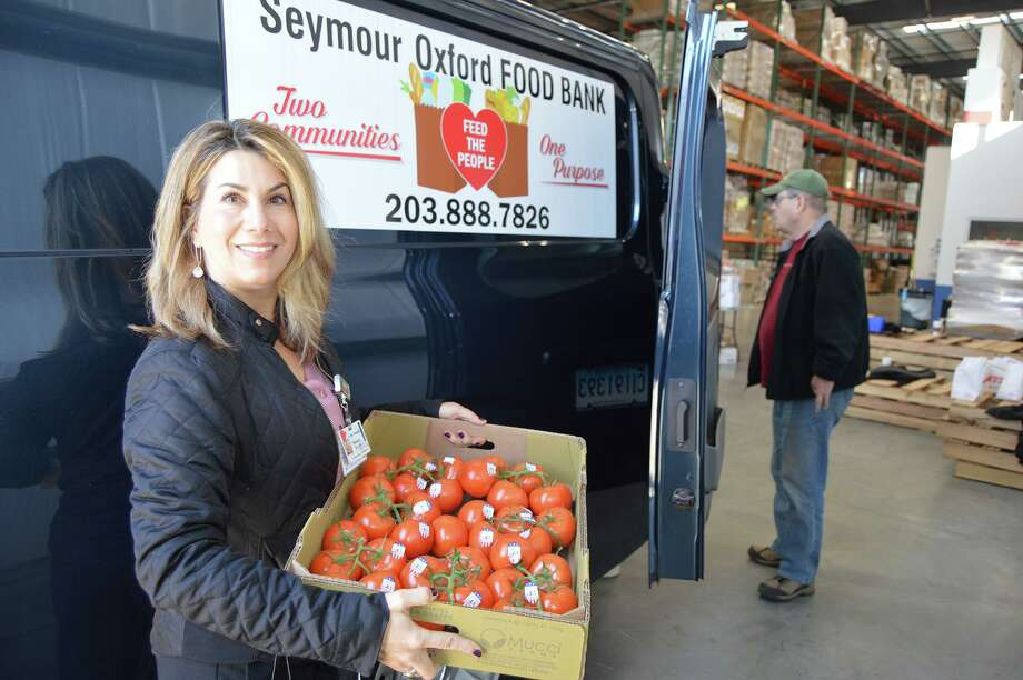 More than 275 cases of fresh, healthy food was distributed to the Valley's food banks earlier this week, thanks to an ongoing initiative to improve the health and well-being of Valley residents. Photo: Contributed Photo