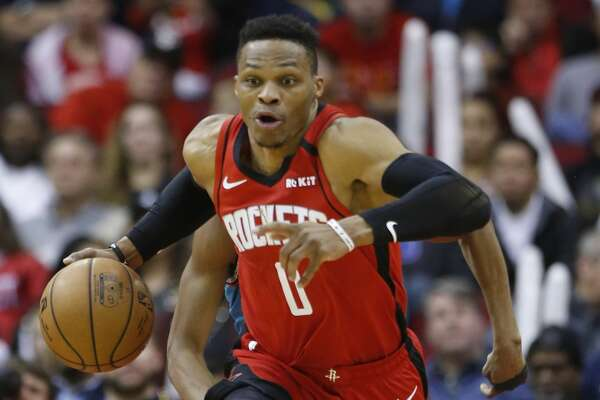 Houston Rockets guard Russell Westbrook sprints the ball up the court after grabbing a rebound against the Memphis Grizzlies during the second half of an NBA basketball game on Wednesday, Feb. 26, 2020, at Toyota Center in Houston.