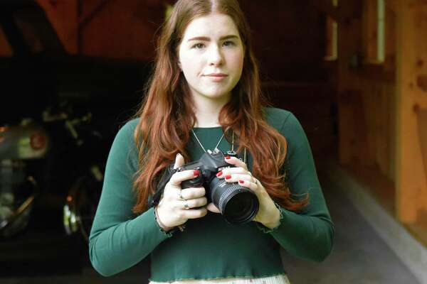 Greenwich artist Sutton Brown Mock poses with her camera at her home in Greenwich, Conn. Wednesday, July 10, 2019.