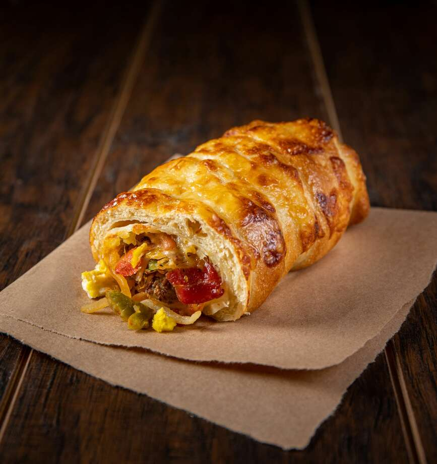A mix between a bagel and burrito, the bagelrito is loaded with all the fixins'; one cage-free egg, thick-cut bacon, turkey sausage, three different cheeses, hash browns, salsa and green chilies in a flour tortilla, hand-wrapped in Asiago bagel dough and baked. Photo: Courtesy Einstein Bros. Bagels