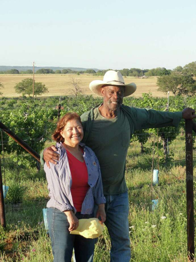 Alfonse Dotson and Martha Cervantes Dotson own Certenberg Vineyards near Voca, Texas in the Hill Country. Dotson was once a professional football player, but has become a vineyard owner in the Hill Country. Photo: Courtesy Photo