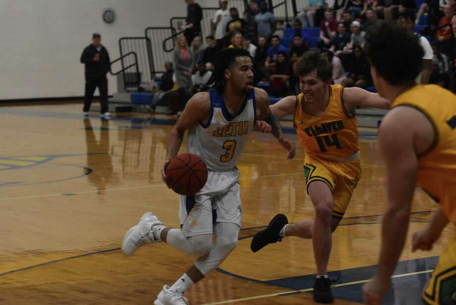 LeTourneau University senior Nate West drives against Belhaven University during their American Southwest Conference game Feb. 25 at Solheim Arena in Longview. West finished a conference-record 67 points. Photo: Natalie Connelly