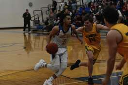 LeTourneau University senior Nate West drives against Belhaven University during their American Southwest Conference game Feb. 25 at Solheim Arena in Longview. West finished a conference-record 67 points.
