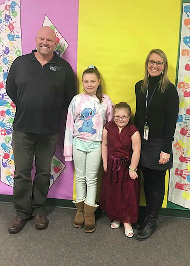 From left are Baldwin Elementary School physical education teacher Mark Cooke, Hailie Simmons, Erin Simmons and principal Joanie Wiersma. (Courtesy photo)