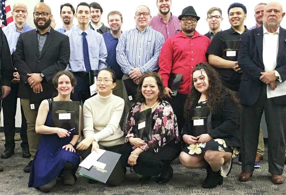 20 Skill Up for Manufacturing students graduated this week from the program at Middlesex Community College in Middletown. Photo: Contributed Photo