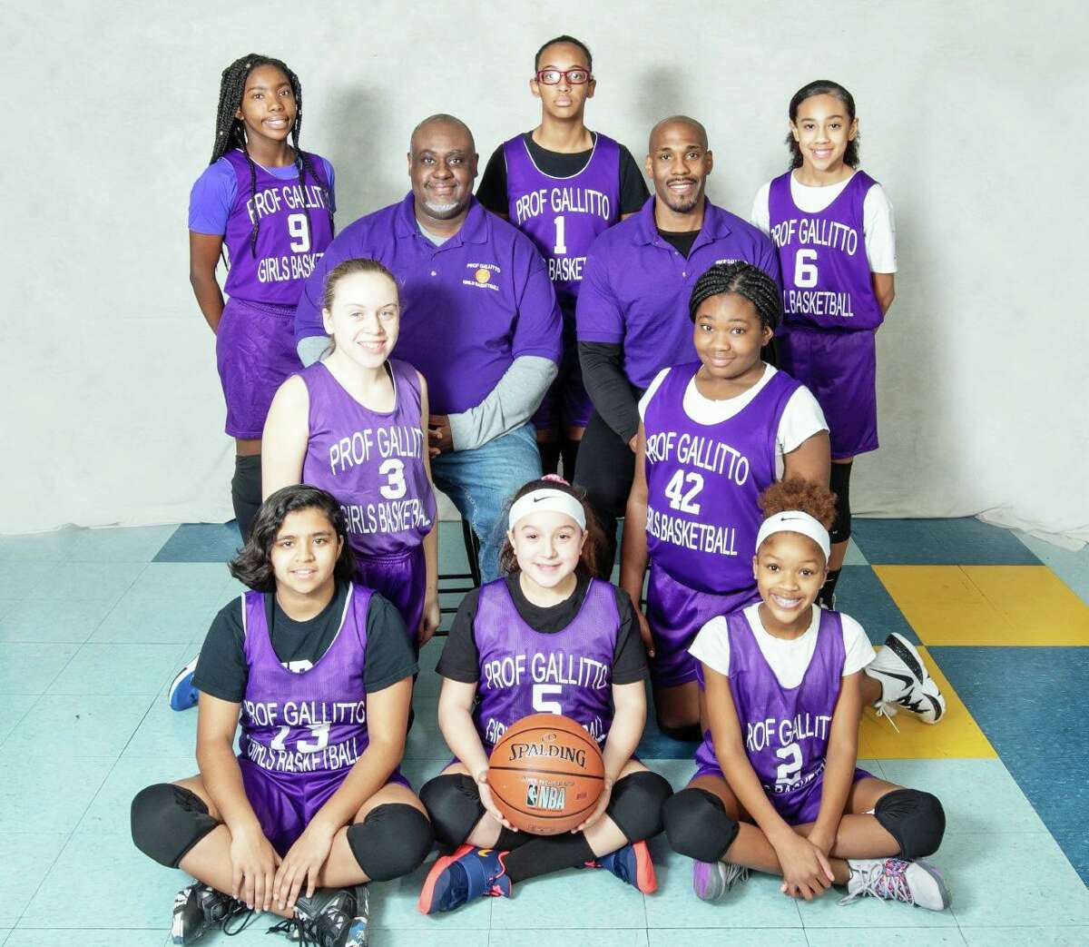 The tournament championship game for the Prof. Gallitto girls basketball league teams (grades six to eight) was held Feb. 15. The winning team was sponsored by Illiano's Ristorante and Pizzeria on Washington Street in Middletown. They were coached by Kevin Butler, left, top row; and Darrin Bryant, right, top row.