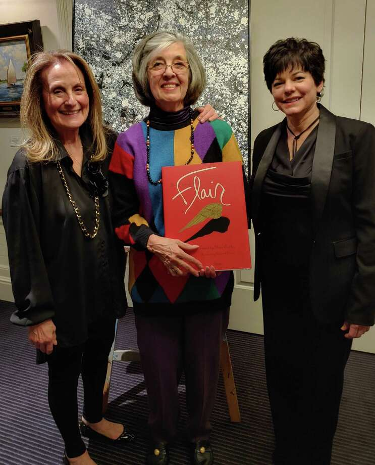 Suzanne Simpson, center, received the Art Society of Old Greenwich's JohnTatge Memorial Volunteer of the Year Award Feb. 21 at ASOG's 2020 Winterfest dinner and art show at the Riverside Yacht Club. ASOG co-presidents Elaine Conner, left, and Julie DiBiase presented the award for Simpson's exceptional volunteer service in chairing the 2019 ASOG Sidewalk Show and Sale. Photo: ASOG / Contributed Photo