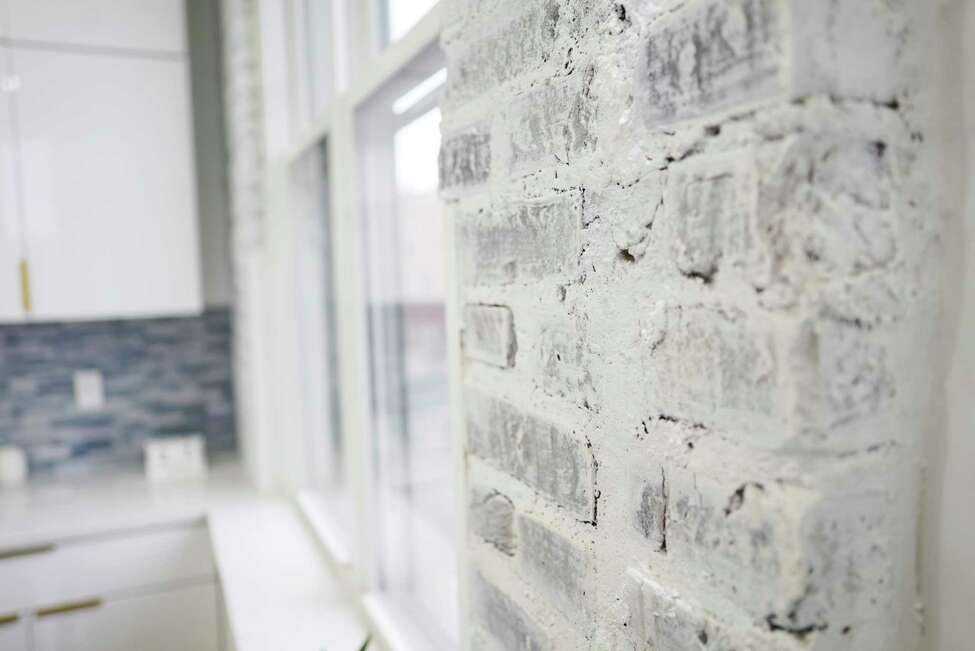 A view of the original brick inside one of the apartments at 95 Remsen Street on Thursday, Feb. 27, 2020, in Cohoes, N.Y. The building has eight new micro apartments. The apartments range in size from 300 to 550 square feet, and the rent will range from $750 to $1100 a month. (Paul Buckowski/Times Union)