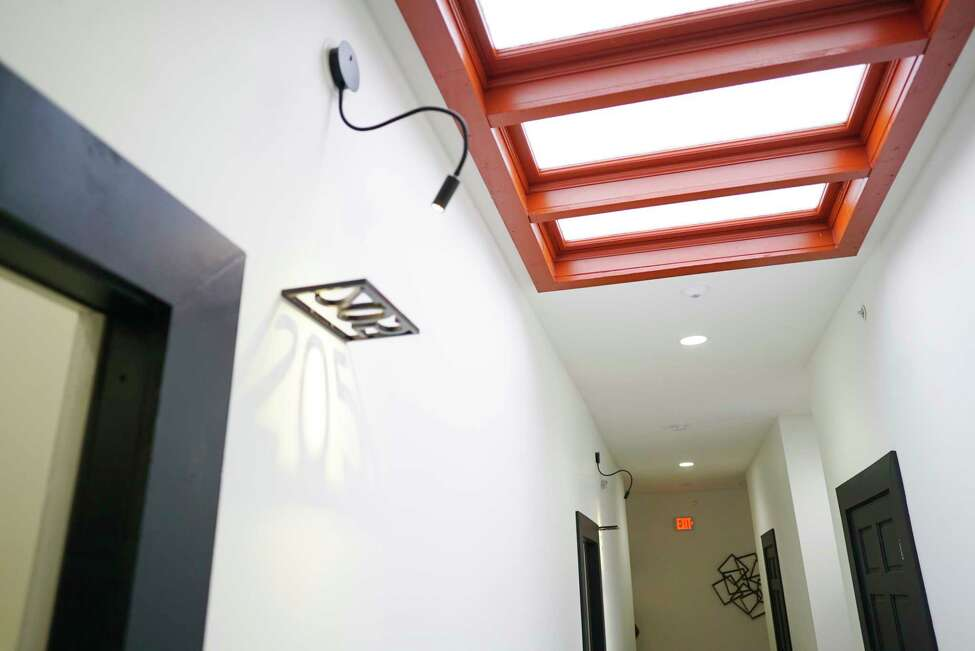 A view looking down the hallway with a skylight at 95 Remsen Street on Thursday, Feb. 27, 2020, in Cohoes, N.Y. The building has eight new micro apartments. The apartments range in size from 300 to 550 square feet, and the rent will range from $750 to $1100 a month. (Paul Buckowski/Times Union)