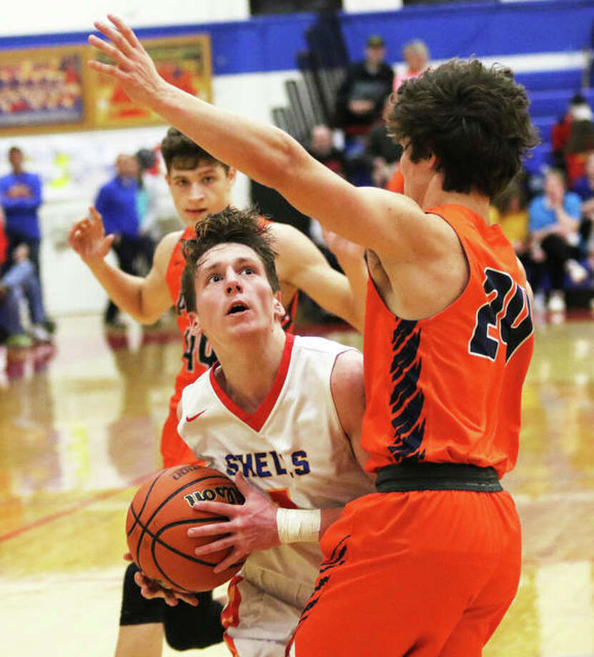 Roxana's Andrew Beckman goes to the basket against Pana's Bryce Edmiston (24) during a SCC game Feb. 11 in Roxana. The Shells are back home at Milazzo Gym this week for the Roxana Class 2A Regional and Beckman scored 13 points in a semifinal win over Greenville on Wednesday. Photo: Greg Shashack / The Telegraph