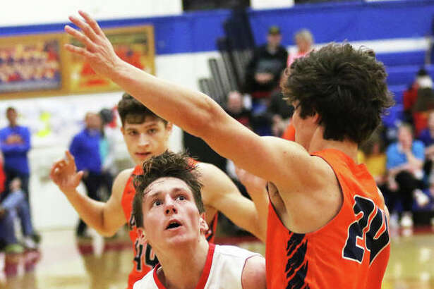 Roxana's Andrew Beckman goes to the basket against Pana's Bryce Edmiston (24) during a SCC game Feb. 11 in Roxana. The Shells are back home at Milazzo Gym this week for the Roxana Class 2A Regional and Beckman scored 13 points in a semifinal win over Greenville on Wednesday.