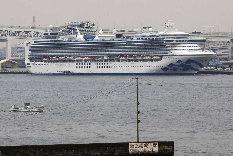 The Diamond Princess cruise ship is anchored at a port in Yokohama, Tuesday, Feb. 25, 2020. Japanese health officials and experts on a government panel acknowledged Monday that the quarantine of the virus-hit cruise ship was not perfect, but defended Japan's decision to release about 1,000 passengers after 14 days.   (Kyodo News via AP) Photo: Associated Press