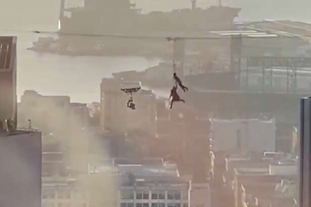 Two people were seen shooting a 'Matrix 4' scene high up between buildings in downtown San Francisco on Thursday, February 27, 2020.