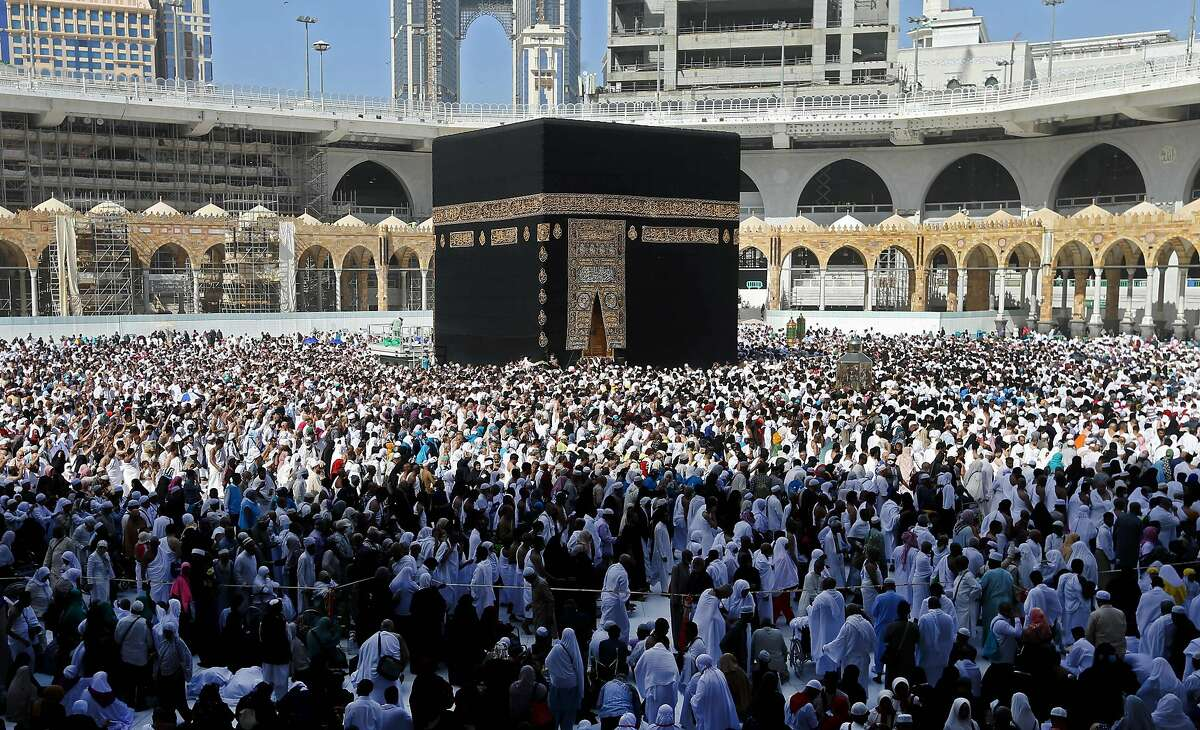 Muslim pilgrims walk around the Kaaba (Tawaf al-Wadaa), Islam's holiest shrine, at the Grand Mosque in Saudi Arabia's holy city of Mecca on February 27, 2020. - Saudi Arabia suspended visas for visits to Islam's holiest sites for the