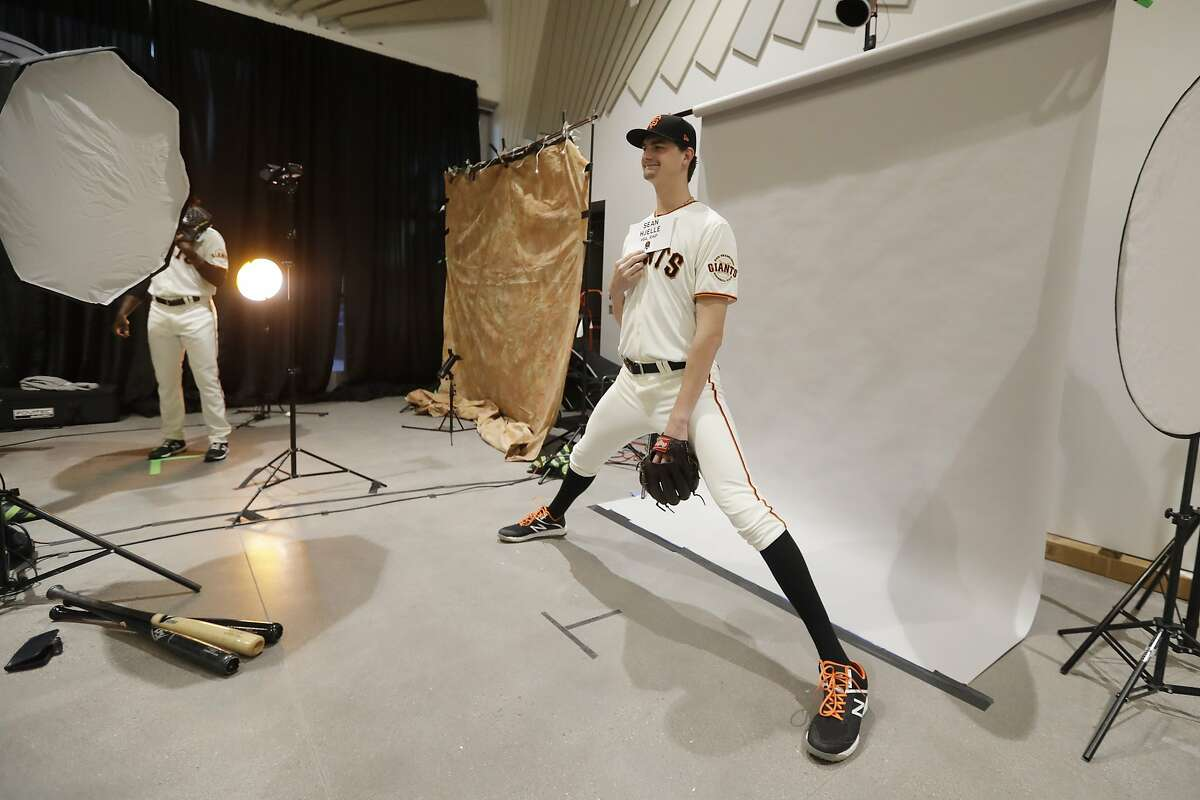 San Francisco Giants' Sean Hjelle poses for a photo during spring training baseball photo day, Tuesday, Feb. 18, 2020, in Scottsdale, Ariz. (AP Photo/Darron Cummings)