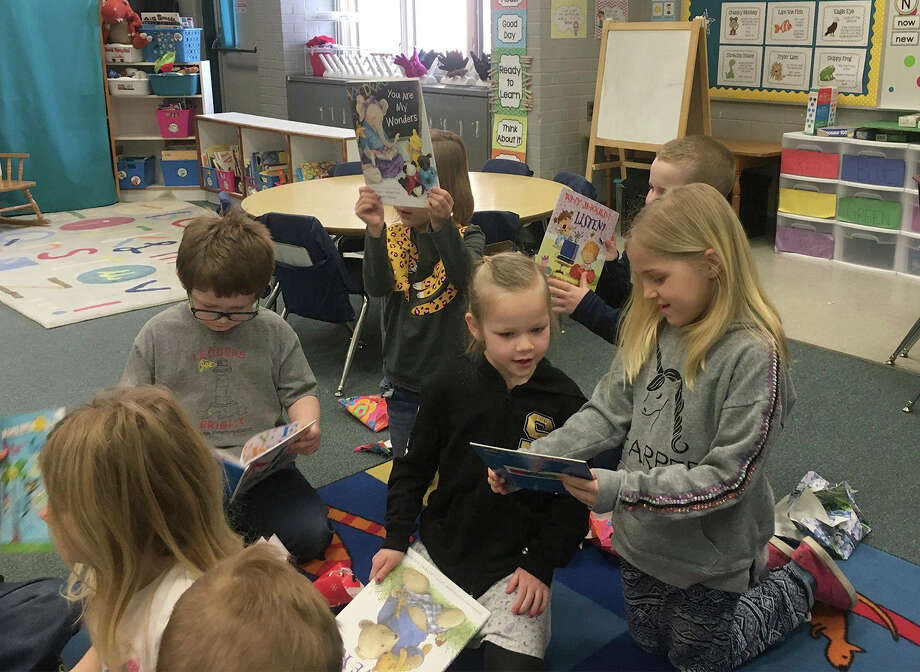Students in Mrs. Amber Smith's kindergarten at Brookside enjoy the books they received from classmate Harper Easler. Photo: Courtesy Photo
