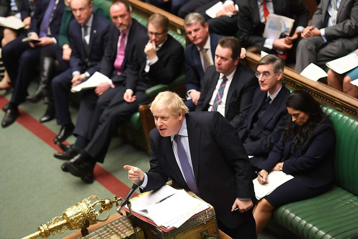 A handout picture released by the UK Parliament shows Britain's Prime Minister Boris Johnson speaking during Prime Minister's Questions (PMQs) in the House of Commons in London on February 26, 2020. (Photo by JESSICA TAYLOR / various sources / AFP) / RESTRICTED TO EDITORIAL USE - MANDATORY CREDIT