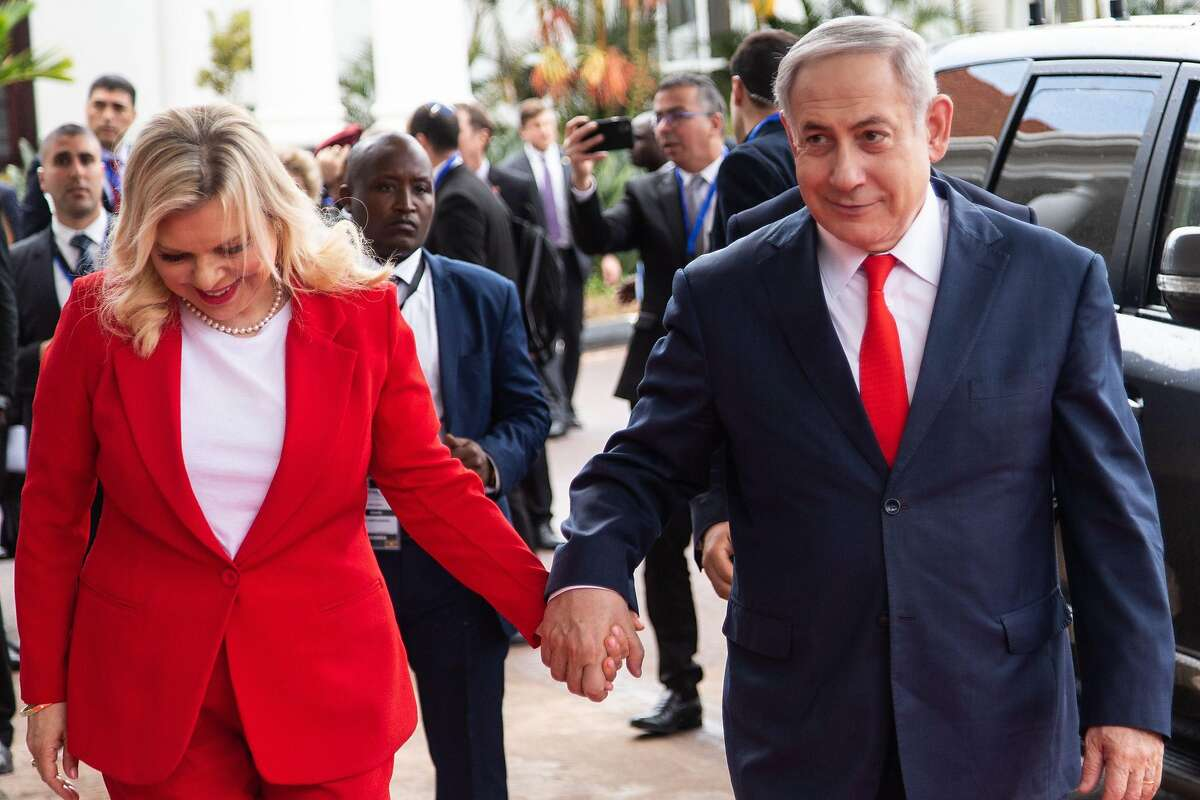 Israeli Prime Minister Benjamin Netanyahu (R) and his wife Sara Netanyahu (L), arrive at the State House in Entebbe, in Uganda on February 3, 2020. (Photo by SUMY SADURNI / AFP) (Photo by SUMY SADURNI/AFP via Getty Images)