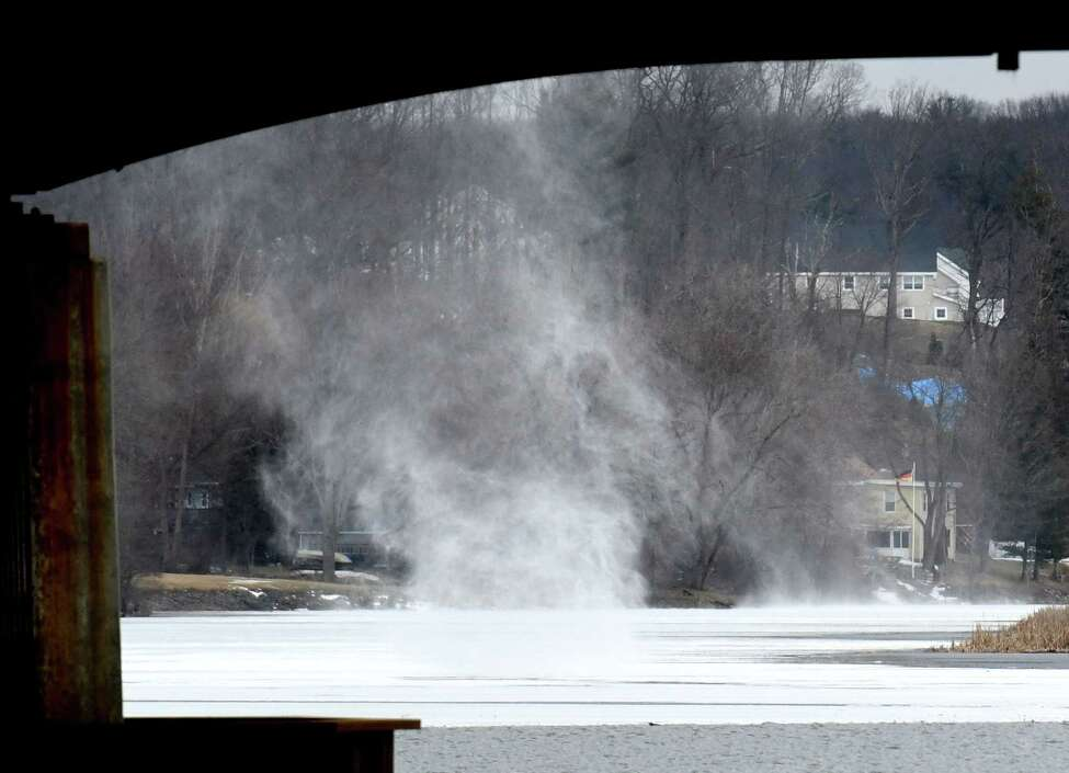 Snow on the Mohawk River is whipped by a strong wind on Thursday, Feb. 27, 2020, seen from Crescent Bridge in Halfmoon, N.Y. (Will Waldron/Times Union)