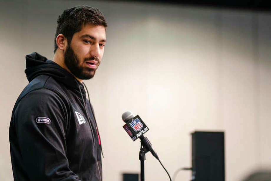Iowa defensive lineman A. J. Epenesa, an Edwardsville High graduate, speaks during a press conference at the NFL football scouting combine Thursday in Indianapolis