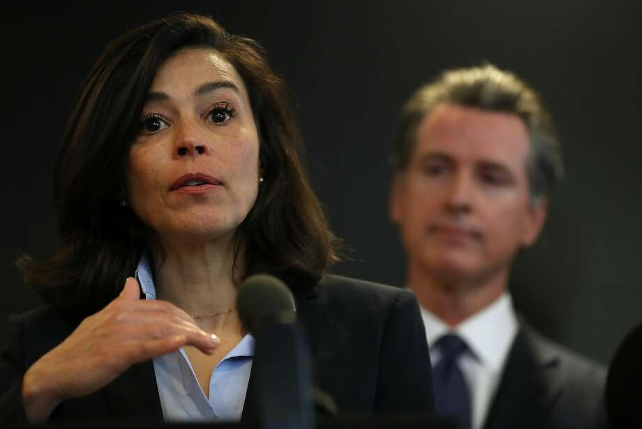 FILE: California Department of Public Health Director and State Health Officer Dr. Sonia Angell (L) speaks as California Gov. Gavin Newsom (R) looks on during a news conference at the California Department of Public Health on February 27, 2020 in Sacramento, California. California Gov. Gavin Newsom joined State health officials to an update to the public about the state's response to the Coronavirus known as COVID-19 a day after a possible first case of person-to-person transmission was reported in Northern California. (Photo by Justin Sullivan/Getty Images) Photo: Justin Sullivan / Getty Images
