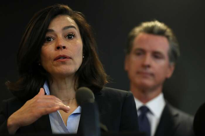 SACRAMENTO, CALIFORNIA - FEBRUARY 27: California Department of Public Health Director and State Health Officer Dr. Sonia Angell (L) speaks as California Gov. Gavin Newsom (R) looks on during a news conference at the California Department of Public Health on February 27, 2020 in Sacramento, California. California Gov. Gavin Newsom joined State health officials to an update to the public about the state's response to the Coronavirus known as COVID-19 a day after a possible first case of person-to-person transmission was reported in Northern California. (Photo by Justin Sullivan/Getty Images)