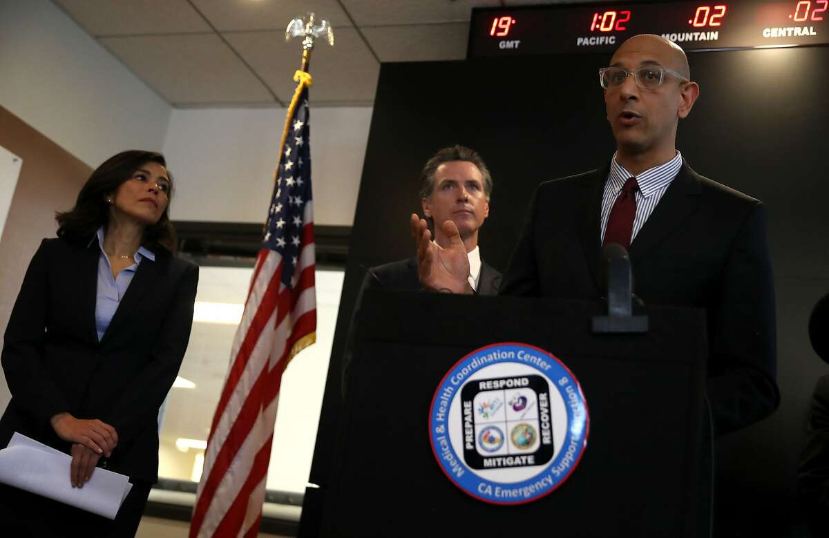 FILE - California Health and Human Services Agency Secretary Dr. Mark Ghaly (R) speaks speaks during a news conference as California Gov. Gavin Newsom (C) and California Department of Public Health Director and State Health Officer Dr. Sonia Angell (L) look on at the California Department of Public Health on February 27, 2020 in Sacramento, Calif.